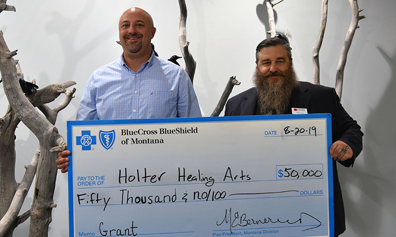 Blue Cross and Blue Shield of Montana's Corey Palmer, left, presents the Holter Museum of Art's Chris Riccardo with a $50,000 Healthy Kids, Healthy Families grant Tuesday in Helena.